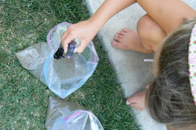 adding food coloring to color sand