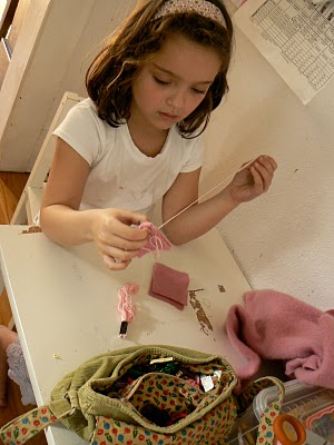 Learning to sew.