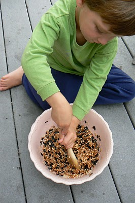 mixing up the gelatine and birdseed for our birdseed cakes