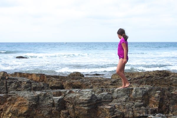 Walking on the rocks at Crystal Cove beach photo