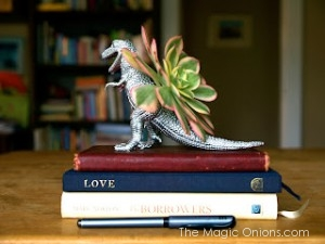 Photo of a dinosaur planter painted silver handmade gift