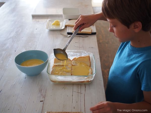 Photo of boy in Kitchen cooking bacon and egg pie - Waldorf recipes